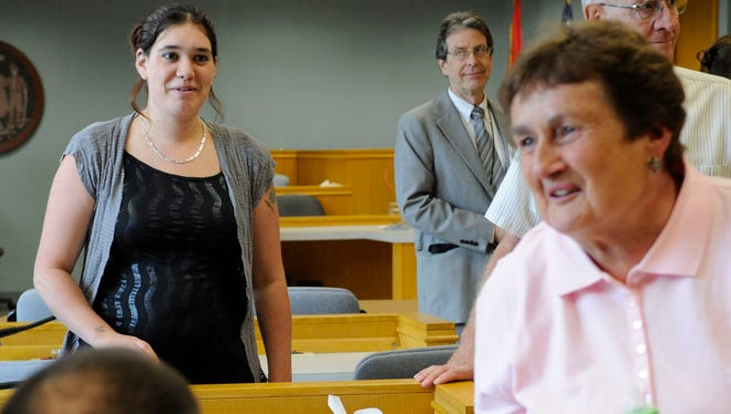 Heather Zemke, left, leaves the courtroom in Aug. 2011 after Michael Haydon was sentenced to life in prison without the possibility of parole for the killing of her father Pat Zemke in 2003.