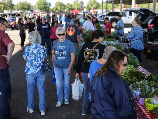 Shoppers check out local produce at the Concho Valley