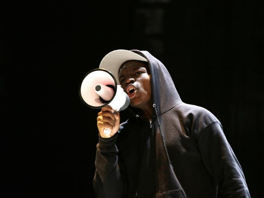 """Actor Amir Randall portrays Trayvon Martin in a scene from the play, """"The Ballad of Trayvon Martin,"""" at the New Freedom Theatre in Philadelphia."""