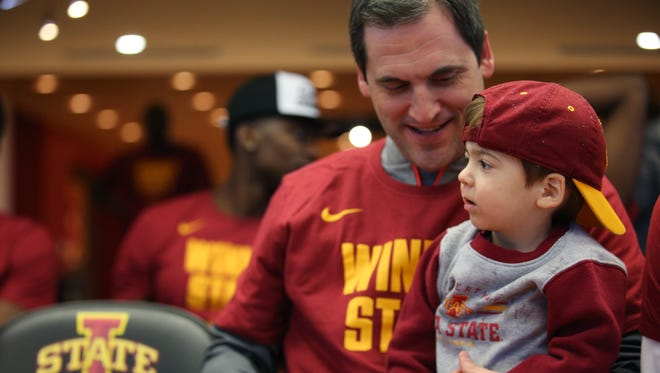 Iowa State coach Steve Prohm tries to convince his son Cass to smile for a photo before the NCAA selection show on Sunday, March 12, 2017, at Johnny's in Hilton Coliseum. The Cyclones will face Nevada in the first round of the NCAA tournament on March 16, in Milwaukee.