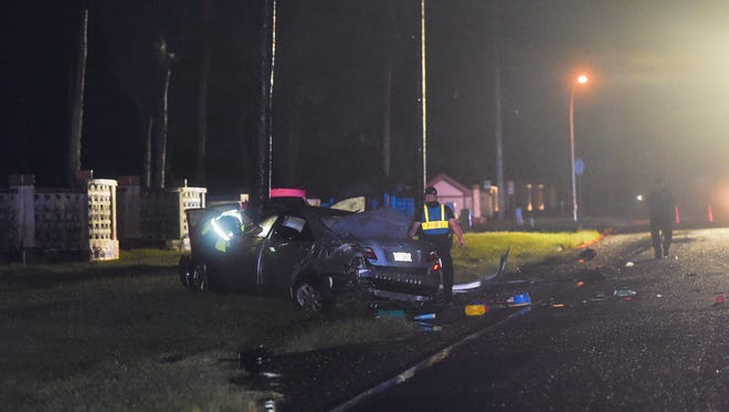 Guam Police Department officers investigate the scene of an auto accident involving a silver Toyota Camry and a red Toyota Corolla near Royal Palms at South Finegayan in Dededo on Nov. 27, 2017. Emergency units arrived on scene at 10:01 p.m., following a 911 call with four patients transported to Guam Memorial Hospital and Guam Regional Medical City, according to Guam Fire Department spokesperson Cherika Chargualaf.