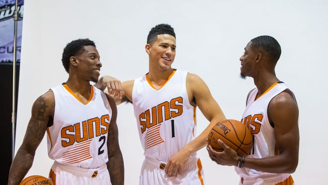 Sep 26, 2016; Phoenix, AZ, USA; (From left) Phoenix Suns guard Eric Bledsoe , guard Devin Booker and guard Brandon Knight pose for a portrait during media day at Talking Stick Resort Arena.