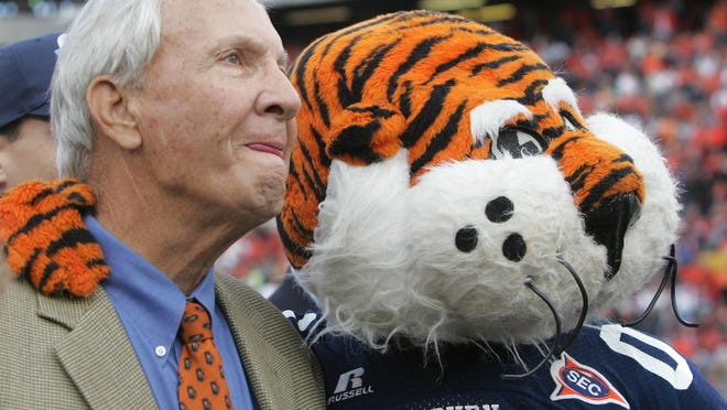 Former Auburn coach Pat Dye watches with Auburn's mascot a video tribute to his career before the start of the Iron Bowl against Alabama, Saturday Nov. 19, 2005 in Auburn, Ala. The school re-named the playing field after him.