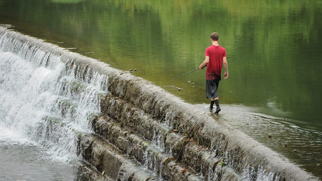 Indiana conservation officer divers have located the body of the missing teenager this morning in the Big Blue River. In this 2012 file photo, a young fisherman takes advantage of low water to walk onto the dam in the Big Blue River in Edinburgh.