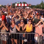 - -5-19-00, 3e The crowd enjoys a performance during Florida SpringFest 1999. _ News Journal file photo- -5-17-99,1B Crowds cheer and sing as Eddie Money performs on the Pepsi stage on the second day of SpringFest Saturday May 15, 1999.