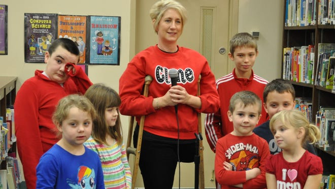 Cline Elementary School counselor Amy Beal hosts a morning news show with students.