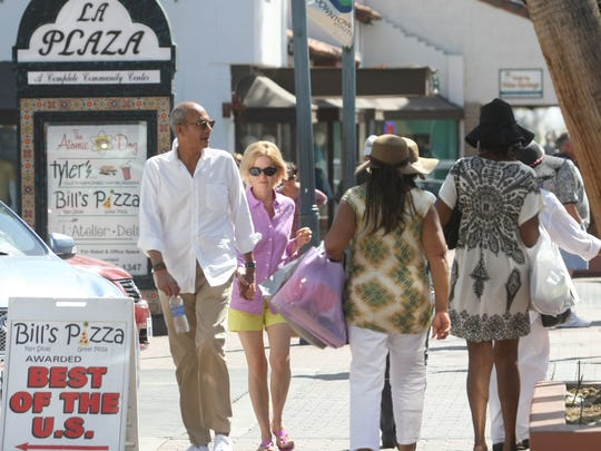 People mill about the La Plaza area in downtown Palm Springs. Built in 1936 and designed by Harry Williams, the Spanish colonial-style shopping center was the first outdoor-oriented shopping center in the country.
