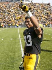 Jordan Canzeri is cheered by Iowa fans after a heroic