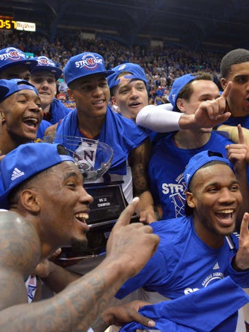 The Kansas Jayhawks players celebrate with the championship