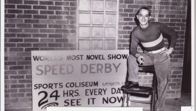 "Nuglin Hendixson, cigarette in hand, poses before a sign advertising the 1948 Speed Derby in Lafayette. Just so you know, I googled ""1948 Speed Derby"" and links to a Soap Box Derby, speed skating and a horse race appeared. So I added Lafayette, La., to it and the only local reference is our SafeSpeed program."