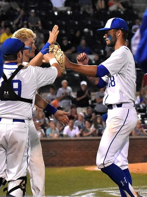 Drew Rom (right) receives congratulations as he gives way to the  bullpen in the 7th inning for Highlands at the 2018 KHSAA State Baseball Semi-Final, June 15, 2018.