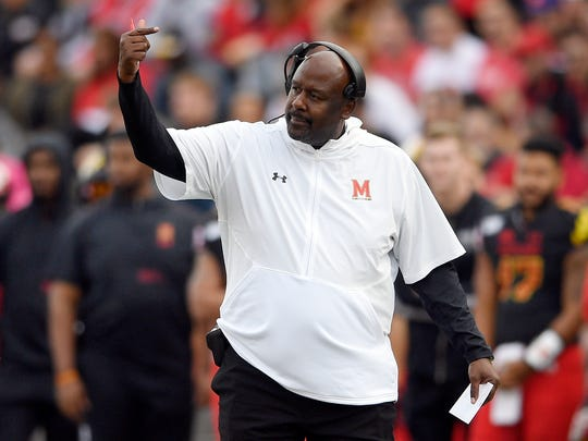 FILE - In this Saturday, Oct. 19, 2019, file photo, Maryland head coach Mike Locksley gestures during the first half of an NCAA football game against Indiana in College Park, Md. In his first year at Maryland, Locksley has formed a close rapport with his players. Although the Terrapins (3-4, 1-3) have dropped four of five and appeared destined for a fourth consecutive losing season, no one has asked for a redshirt. (AP Photo/Nick Wass, File)