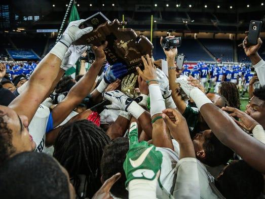 Detroit Cass Tech's players celebrate winning the title