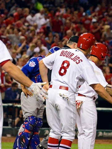 Cardinals third baseman Matt Carpenter celebrates with