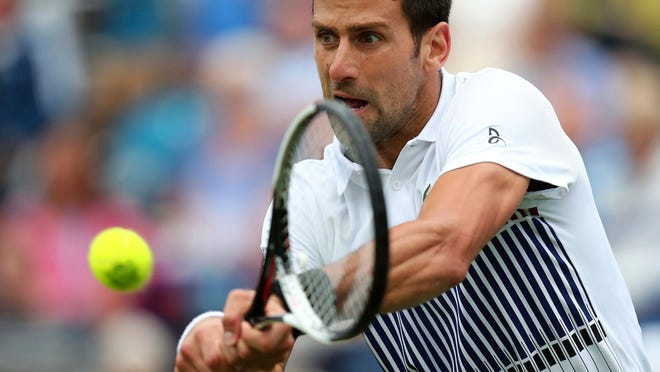 CAPTION CORRECTS MATCH INFORMATION Serbia's Novak Djokovic plays a return to Canada's Vasek Pospisil during their round of 16 match on day five of the AEGON International tennis tournament at Devonshire Park, Eastbourne, England, Wednesday June 28, 2017. (Gareth Fuller/PA via AP)