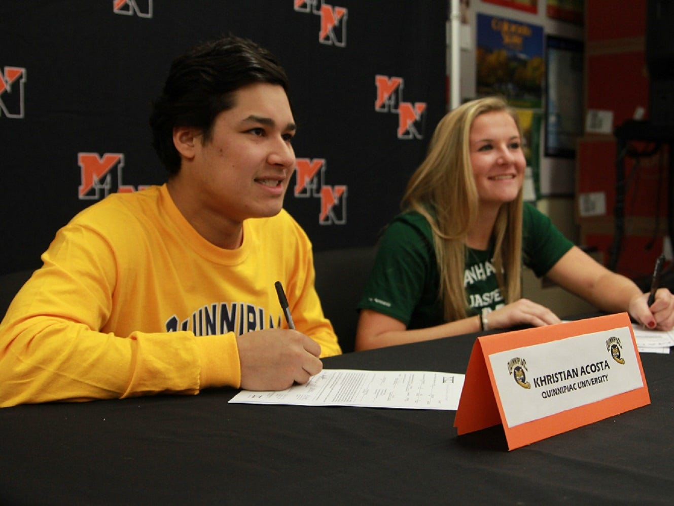Khristina Acosta (left) and Christine Gebhardt (right) sign National Letters of Intent at Middletown North.