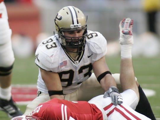 Purdue's Rob Ninkovich sacks Wisconsin's John Stocco in 2005.