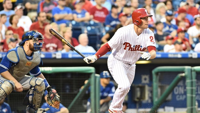 Phillies left fielder Cody Asche hits an RBI double during the fourth inning against the Toronto Blue Jays at Citizens Bank Park.