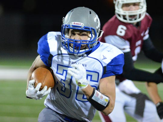 Green Bay Southwest running back Taylor VanRite gets in the open Friday's game at De Pere.