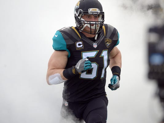FILE - In this Dec. 4, 2016, file photo, Jacksonville Jaguars middle linebacker Paul Posluszny (51) takes the field during introductions before an NFL football game against the Denver Broncos, in Jacksonville, Fla. Posluszny has 1,200 tackles, 16 sacks and 15 interceptions in 11 years in the NFL _ and finally has his first winning season. Jacksonville's ninth victory secured the milestone for Posluszny, whose career achievement was recognized by teammates and coaches in the locker room. (AP Photo/Phelan M. Ebenhack, File)