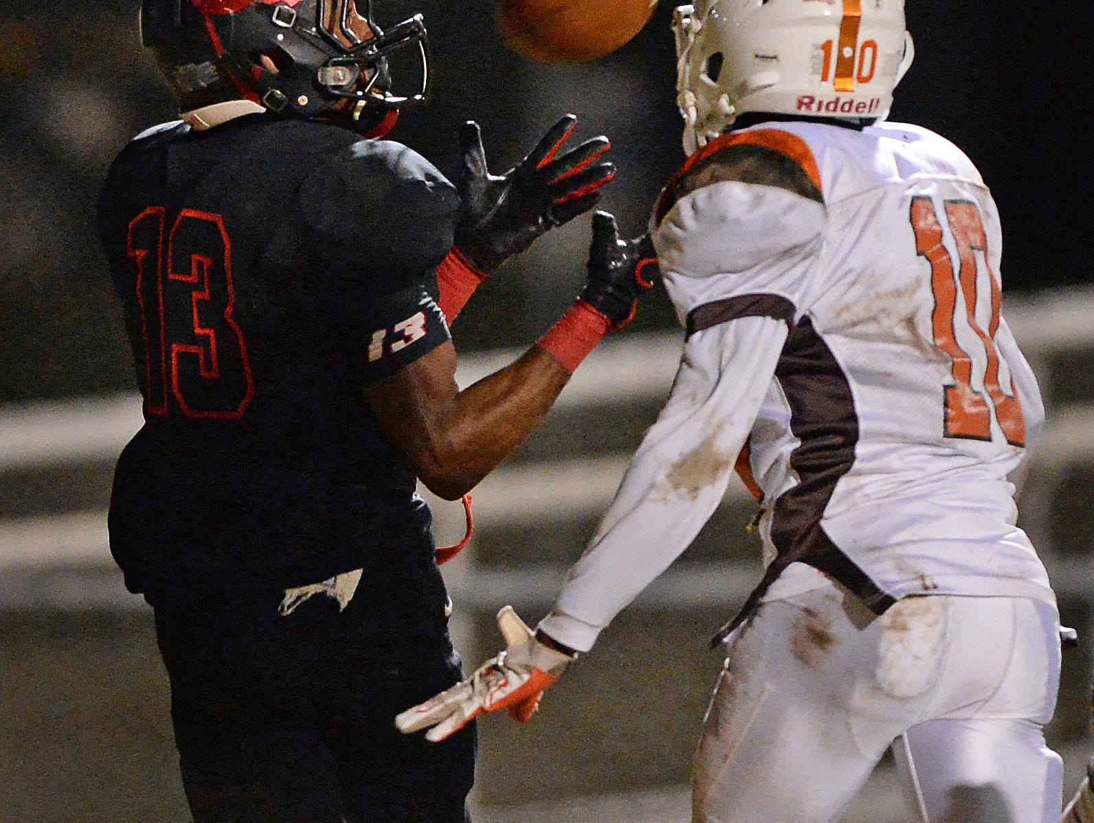 Hillcrest's Brandon Peppers (13) catches a TD past Mauldin's Winston Howard (10) during the first round of the Class AAAA Division-I playoffs Friday, November 20, 2015 at Hillcrest High.