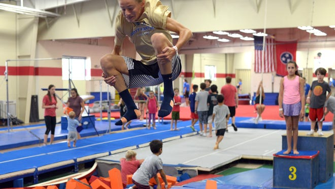 Werner Campbell, 13, flips fast through the air as kids overrun the MPACT Sports facility in Cool Springs on Saturday as they host the 3rd annual Back to School Block Party.