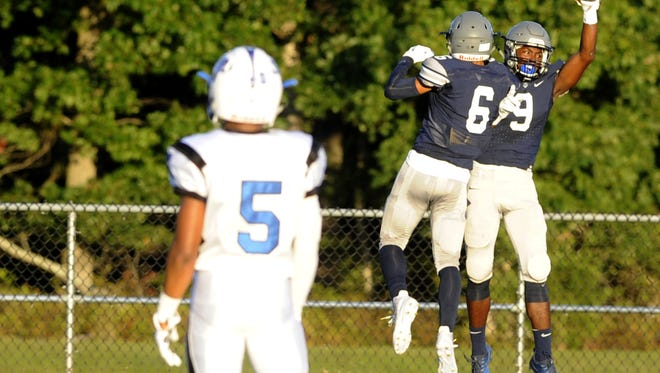 Jaylen DeCoteau (9) of St. Augustine celebrates his interception for a touchdown with teammate Sincere Rhea in the second quarter of Friday's game at St. Augustine Prep. September 15th 2017