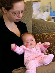 Ruth Brown holds her 2-month-old daughter, Pearl Joy,