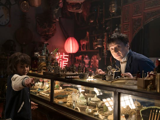 Jackie Chan (right) plays a shop owner who imparts
