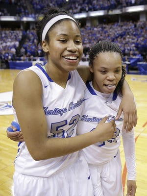 Heritage Christian Eagles Tyasha Harris (52) hugs DaShawna Harper (23) as they celebrate winning the 3A IHSAA Girls Basketball State Finals Saturday, Feb 27, 2016, afternoon at Bankers Life Fieldhouse. The Heritage Christian Eagles defeated the North Harrison Lady Cats 51-45.