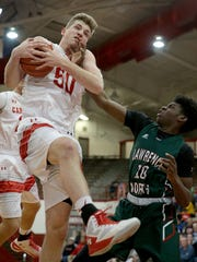 Southport's Joey Brunk (50) pulls in a rebound over Lawrence North's Dexter Shouse (10).
