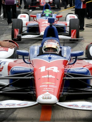 AJ Foyt Racing IndyCar driver Carlos Munoz (14) and Conor Daly (4) wait to his the track during practice for the Indianapolis 500 Friday, May 19, 2017, afternoon at the Indianapolis Motor Speedway.