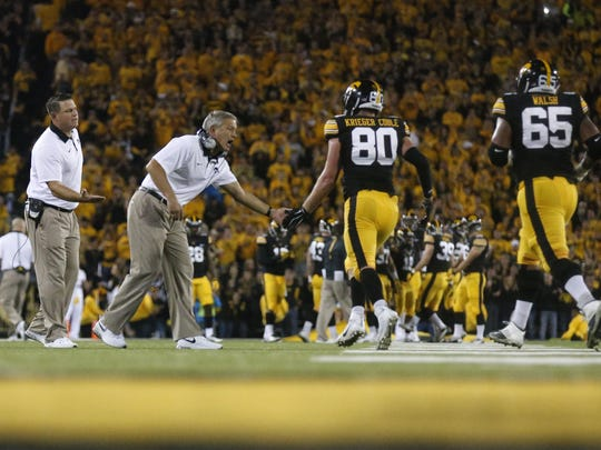 Iowa head coach Kirk Ferentz celebrates with members of his offense after a touchdown against Pitt on  Sept. 19, 2015, at Kinnick Stadium in Iowa City.