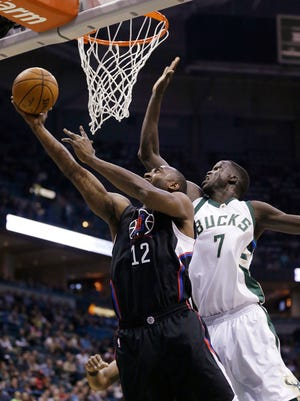 Luc Richard Mbah a Moute of the Clippers puts up a shot against the Bucks' Thon Maker.