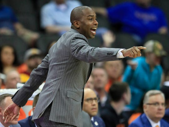 Oklahoma State head coach Mike Boynton directs his team during the first half of an NCAA college basketball game against Iowa State in the first round of the Big 12 men's basketball tournament in Kansas City, Kan., Wednesday, March 11, 2020. (AP Photo/Orlin Wagner)