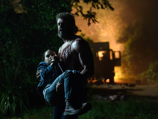 Logan (Hugh Jackman) saves young Laura (Dafne Keen)
