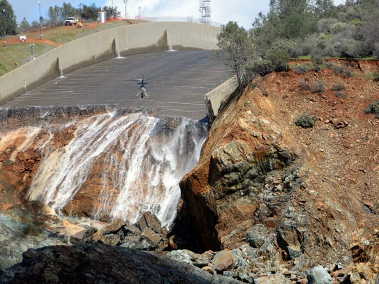 Oroville Dam's crippled spillway is inspected via a