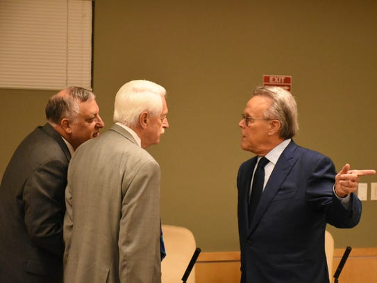 Marco Island City Council Chair Larry Honig, right,