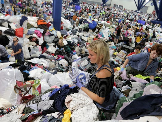 Kathryn Loder sorts donated clothing at George R. Brown