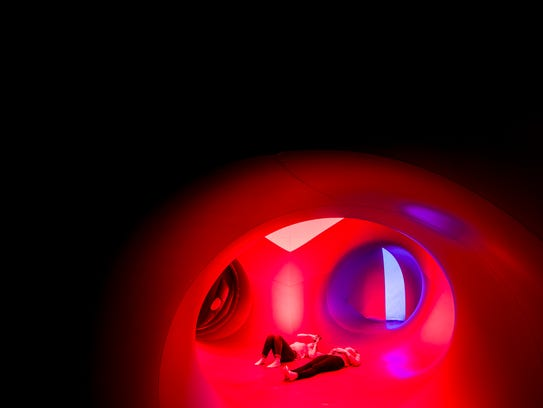 Visitors explore the Architects of Air luminarium in