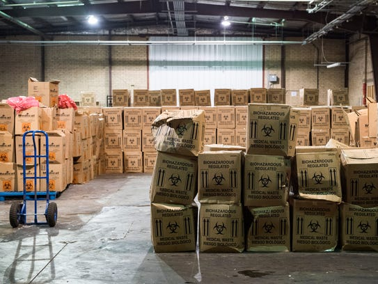Boxes of medical waste sit in the SterAssure Processing