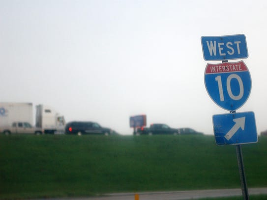 Traffic is seen backed up on I-10 after heavy downpours