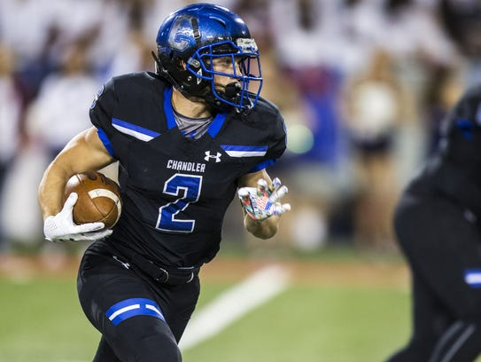 Chandler's Drake Anderson rushes against Perry in the