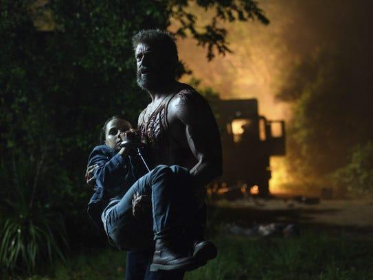 Dafne Keen (left) and Hugh Jackman appear in a scene