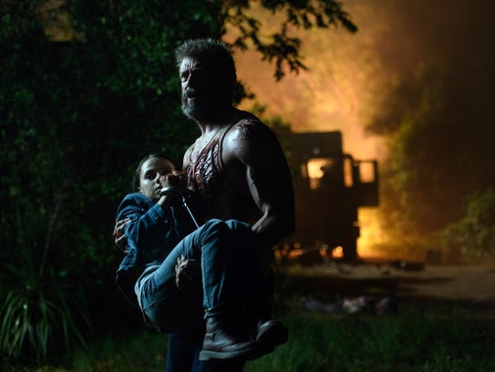 "Dafne Keen, left, and Hugh Jackman in a scene from ""Logan."""