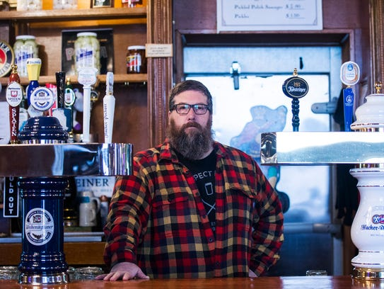 Jeff Bruning, co-owner of Full Court Press, stands