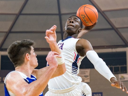 Greg Williams Jr. dunks the ball as LCA takes on St.