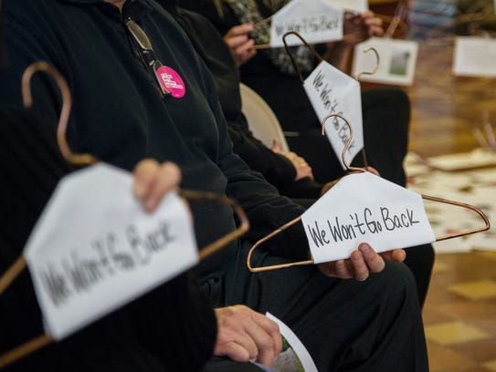 Planned Parenthood Voters of Iowa hold a small protest
