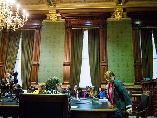 Legislators listen to public comment during a hearing