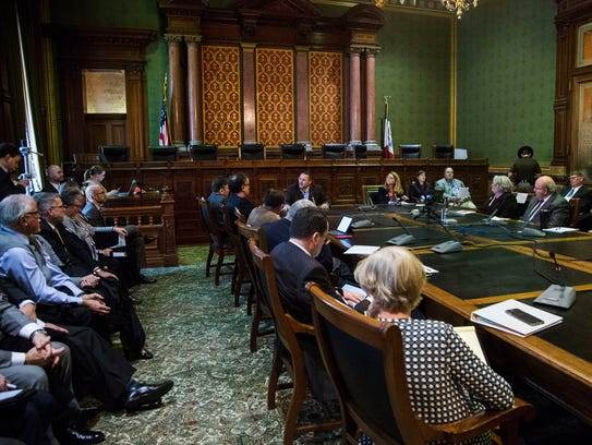 Community members speak to legislators during a public